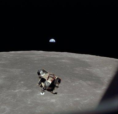 Apollo 11 Mission image - View of Moon limb and Lunar Module during ascent,Mare Smythii,Earth on horizon