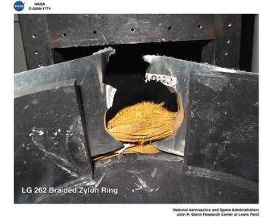 BALLISTIC IMPACT LABORATORY SPECIMENS OF BRAIDED KEVLAR RING AND BRAIDED NYLON RING AFTER IMPACT TESTING