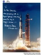 Personalized note and signed photographic print of a Saturn 5 launch to Dr. Abe Silverstein, director of lewis Research Center, from Wernher Von Braun.