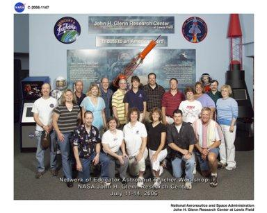 Network of Educator Astronaut Teachers (NEAT) Group Photo in front of the John Glenn gallery at the NASA Glenn Research Center Visitor Center