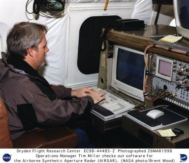 Operations Manager Tim Miller checks out software for the Airborne Synthetic Aperature Radar (AIRSAR