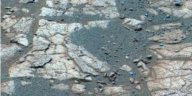 Rind-Like Features at a Meridiani Outcrop