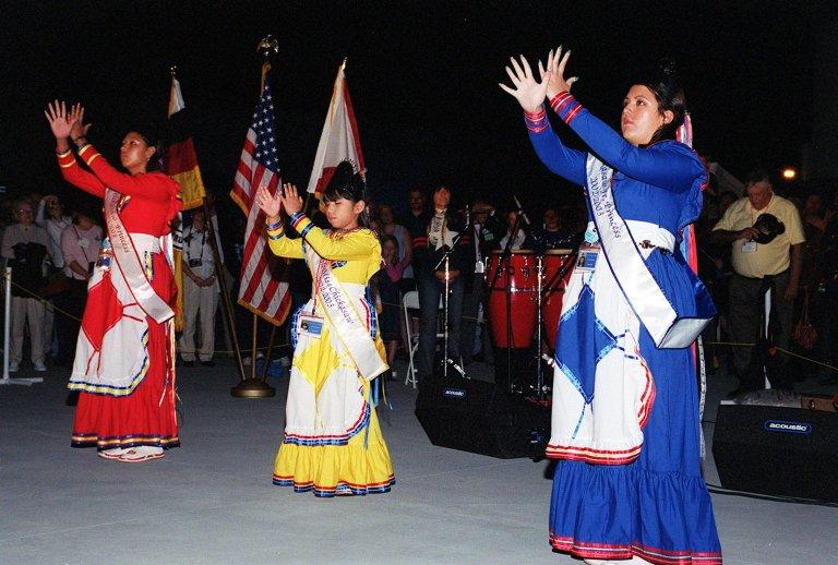 """KENNEDY SPACE CENTER, FLA. - Chickasaw Indian princesses """"sign"""" the Lord's Prayer during a Native American Ceremony at the Rocket Garden in the KSC Visitor Complex. The princesses are Crystal Underwood, Julie Underwood and Tamela Alexander. The ceremony was part of several days' activities commemorating John B. Herrington as the first tribally enrolled Native American astronaut to fly on a Shuttle mission. Herrington is a Mission Specialist on STS-113."""