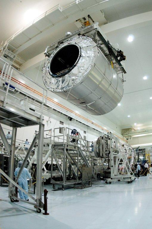 KENNEDY SPACE CENTER, FLA. - A worker on the floor watches as the Multi-Purpose Logistics Module Raffaello moves toward another work stand in the Space Station Processing Facility. Raffaello is the second MPLM built by the Italian Space Agency, serving as a reusable logistics carrier and primary delivery system to resupply and return station cargo requiring a pressurized environment. It has been moved across the floor to allow the third MPLM, Donatello, to be brought in for routine testing. Donatello has been stored in the Operations and Checkout Building. This is the first time all three MPLMs are in the SSPF; the other one is the Leonardo. Raffaello is scheduled to fly on Space Shuttle Atlantis on mission STS-114.