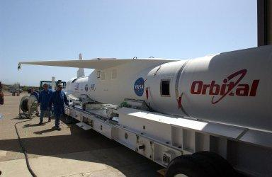 KENNEDY SPACE CENTER, FLA. -- The mated Pegasus XL rocket - AIM spacecraft is secured onto a transporter at Vandenberg Air Force Base in California. The rocket will be transferred to a waiting Orbital Sciences Stargazer L-1011 aircraft for launch. AIM, which stands for Aeronomy of Ice in the Mesosphere, is being prepared for integrated testing and a flight simulation. The AIM spacecraft will fly three instruments designed to study polar mesospheric clouds located at the edge of space, 50 miles above the Earth's surface in the coldest part of the planet's atmosphere. The mission's primary goal is to explain why these clouds form and what has caused them to become brighter and more numerous and appear at lower latitudes in recent years. AIM's results will provide the basis for the study of long-term variability in the mesospheric climate and its relationship to global climate change. Launch is scheduled for April 25.