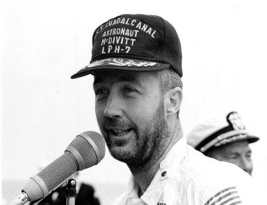 ABOARD THE USS GUADALCANAL -- Bearded Apollo 9 commander James A. McDivitt speaks to personnel aboard the USS Guadalcanal, prime recovery ship, an hour after he and astronauts David R. Scott and Russell L. Schweickart splashed down today in the Atlantic Ocean, 780 nautical miles southeast of Cape Kennedy. Their 10-day Earth orbital flight verified a lunar landing later this year. The National Aeronautics and Space Administration directs the Apollo program.