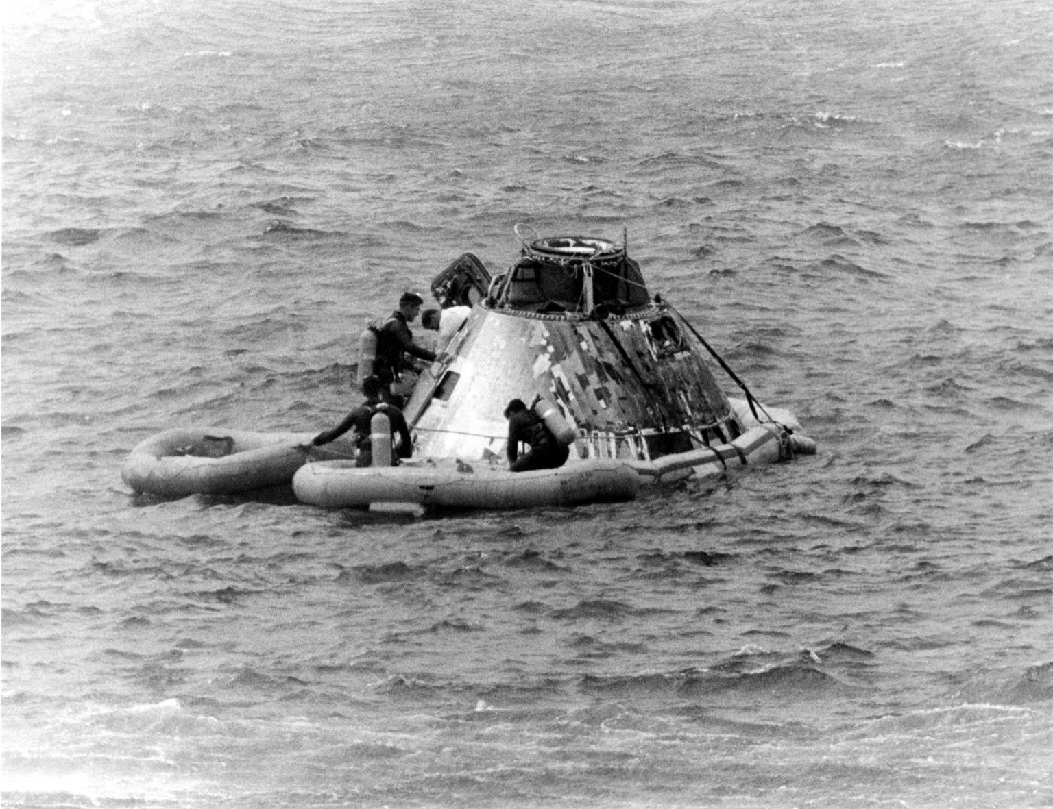 KENNEDY SPACE CENTER, FLA. -- Pararescueman helps Apollo 9 Command Module Pilot David R. Scott from the spacecraft today during recovery at completion of the 10-day Earth orbital flight with James A. McDivitt and Russell L. Schweickart, still in the spacecraft. The astronauts splashed down less than five miles from the USS Guadalcanal, prime recovery ship, at the beginning of their 152nd revolution. During the highly successful flight, they extensively tested the lunar module spacecraft, paving the way for a similar one to carry Americans to the Moon later this year. They were lalunched March 3 by an Apollo/Saturn V space vehicle from the Kennedy Space Center at the start of NASA's third manned mission using an Apollo spacecraft.