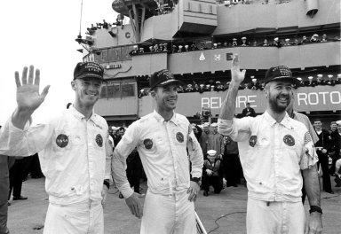 KENNEDY SPACE CENTER, FLA. -- Wearing flight caps presented to them by the crew of the USS Guadalcanal, bearded Apollo 9 astronauts (left to right) Russell L. Schweickart, David R. Scott and James A. McDivitt, wave to well-wishers aboard the recovery ship at the completion of their 10-day Earth orbital mission. Their spacecraft splashed down 780 nautical miles southeast of Cape Kennedy at 12:01 p.m. EST, March 13, 1969. During the textbook mission, the space pilots verified a lunar module spacecraft similar to the one that is to land Americans on the Moon later this year. Their flight began March 3 when they were launched by an Apollo/Saturn V rocket from the Kennedy Space Center. The National Aeronautics and Space Administration directs the Apollo program.
