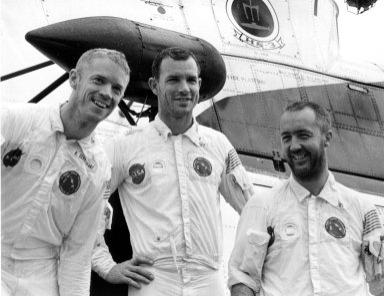 KENNEDY SPACE CENTER, FLA. -- Bearded and smiling, Apollo 9 astronauts, left to right, Russell L. Schweickart, David R. Scott and James A. McDivitt, pause in front of recovery helicopter, which carried them a short distance from their spacecraft's impact point to the USS Guadalcanal, prime recovery ship. They splashed down today less than five miles from the Guadalcanal, 780 nautical miles southeast of Cape Kennedy. The astronauts reentered at the beginning of their 152nd Earth orbit following a textbook flight that verified a lunar module spacecraft. It was similar to the one that is to land Americans on the Moon later this year. They were launched March 3, 1969, from the Kennedy Space Center aboard an Apollo/Saturn V space vehicle. The National Aeronautics and Space Administration directs the Apollo program.