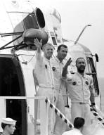 KENNEDY SPACE CENTER, FLA. -- One hour after their Apollo 9 spacecraft splashed down today in the Atlantic Ocean, waving astronauts, left to right, Russell L. Schweickart, David R. Scott and James A. McDivitt, descend stairway on to main deck of the USS Guadalcanal, prime recovery ship. The helicopter flew them from their impact point a short distance to the ship, originally positioned less than five miles from where they splashed down. The 10-day Earth orbital mission proved the feasibility of the lunar module for manned descent to the Moon's surface, scheduled to take place later this year. They wre launched March 3, 1969, from the Kennedy Space Center aboard an Apollo/Saturn V space vehicle. The National Aeronautics and Space Administration directs the Apollo program.