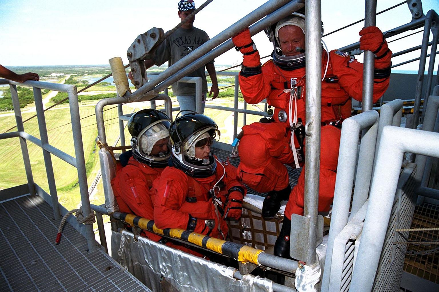 KENNEDY SPACE CENTER, Fla. -- STS-86 Mission Specialist Jean-Loup J.M. Chretien of the French Space Agency, CNES, prepares to join his fellow crew members, Mission Specialists Wendy B. Lawrence and David A. Wolf, at far left, in a slidewire basket during emergency egress training at Launch Pad 39A. The crew is at KSC to participate in the Terminal Countdown Demonstration Test (TCDT), a dress rehearsal for launch. STS-86 will be the seventh docking of the Space Shuttle with the Russian Space Station Mir. Liftoff of the Space Shuttle Atlantis on Mission STS-86 is targeted for Sept. 25