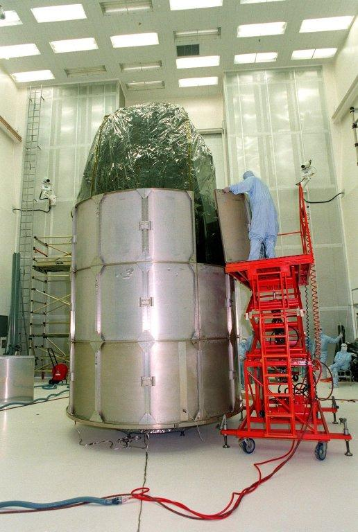NASA's Far Ultraviolet Spectroscopic Explorer (FUSE) satellite is fitted with another row of canister segments before being moved to Launch Pad 17A, CCAS. FUSE was developed by The Johns Hopkins University under contract to Goddard Space Flight Center, Greenbelt, Md., to investigate the origin and evolution of the lightest elements in the universe hydrogen and deuterium. In addition, the FUSE satellite will examine the forces and process involved in the evolution of the galaxies, stars and planetary systems by investigating light in the far ultraviolet portion of the electromagnetic spectrum. FUSE is scheduled to be launched June 23 aboard a Boeing Delta II rocket
