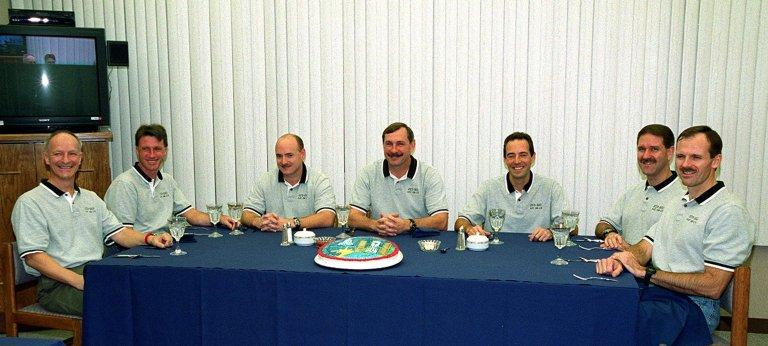 In the Operations and Checkout Building, the STS-103 crew are all smiles as they gather for breakfast before suiting up for launch. From left are Mission Specialists Claude Nicollier of Switzerland and C. Michael Foale (Ph.D.), Pilot Scott J. Kelly, Commander Curtis L. Brown Jr., and Mission Specialists Jean-Francois Clervoy of France, John M. Grunsfeld (Ph.D.) and Steven L. Smith. Nicollier and Clervoy are with the European Space Agency. The STS-103 mission, to service the Hubble Space Telescope, is scheduled for launch Dec. 17 at 8:47 p.m. EST from Launch Pad 39B. Mission objectives include replacing gyroscopes and an old computer, installing another solid state recorder, and replacing damaged insulation in the telescope. The mission is expected to last about 8 days and 21 hours. Discovery is expected to land at KSC Sunday, Dec. 26, at about 6:30 p.m. EST