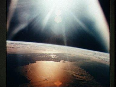 Morning sun on Gulf of Mexico as seen from the Apollo 7 spacecraft