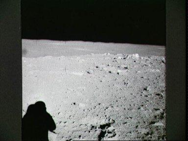 Apollo 14 crewmen photographs field of boulders on flank of Cone Crater