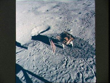 U.S. flag, footprints and portable work bench on lunar surface