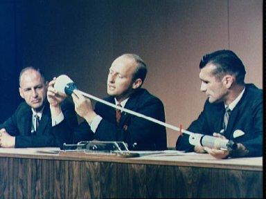 Astronauts Conrad and Gordon demonstrate tethering procedures for news media