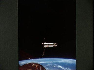Gemini 11 spacecraft and Agena Target Vehicle during tether disconnect