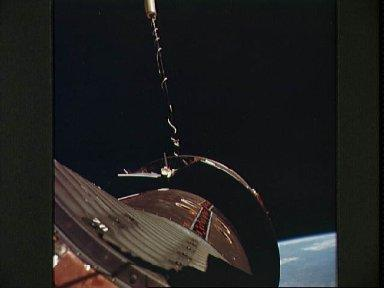 Nose of Gemini 11 spacecraft and Agena Target Vehicle as seen during EVA