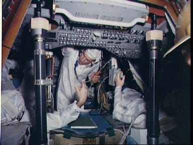 Astronauts in Apollo spacecraft 101 Command module for fit and function test