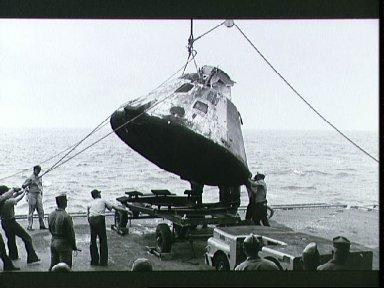Apollo spacecraft 017 lowered on to deck of U.S.S. Bennington