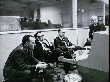 Scene at the Flight Operations Director's console during Apollo 6