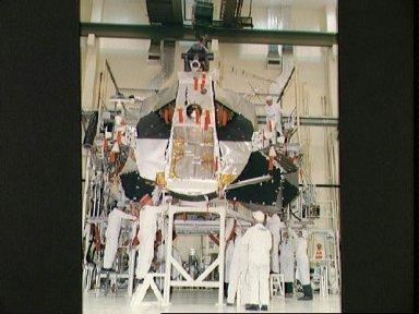 Ascent stage of Lunar Module 3 being uncrated and moved