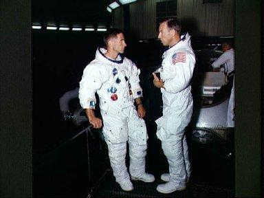 Two members of Apollo 8 crew suited up for centrifuge training