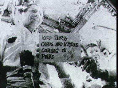Astronauts Schirra and Eisele seen in first live television transmission