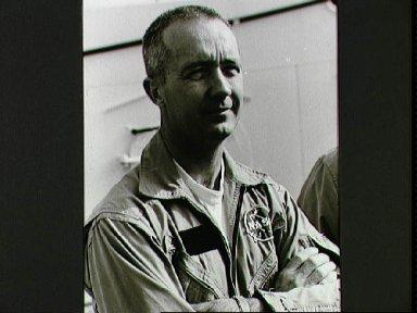 Astronaut James A. McDivitt on deck of ship prior to water egress training