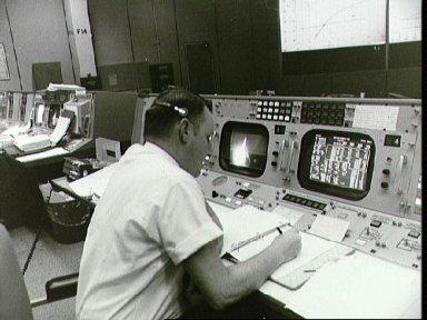 Clifford Charlesworth seated at his console in Mission Control Room