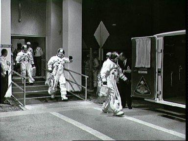 Apollo 8 crew leaves Manned Spacecraft Operations Bldg during countdown