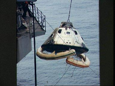 Apollo 9 Command Module is hoisted aboard the U.S.S. Guadalcanal