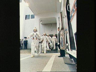 Apollo 9 crew leaves Spacecraft Operations Building during countdown