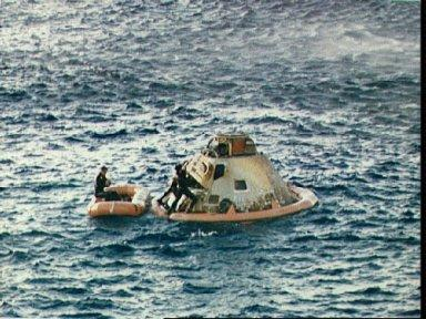 Apollo 10 spacecraft with Navy swimmers floating in recovery area