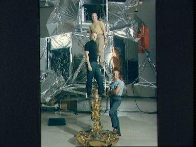 Apollo 14 prime crew standing in front of a Lunar Module mock-up