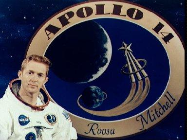 Astronaut Stuart A. Roosa pictured in front of Apollo 14 insignia