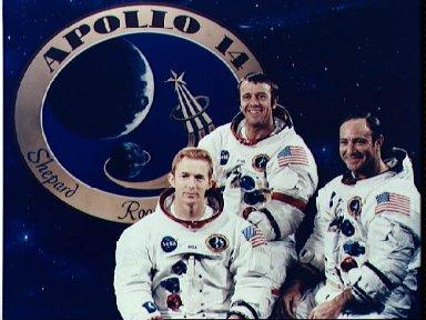 Apollo 14 crewmembers pictured in front of mission emblam