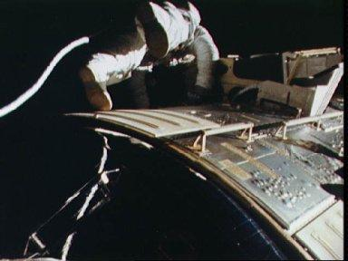 Astronaut Alfred Worden floats in space outside spacecraft during EVA