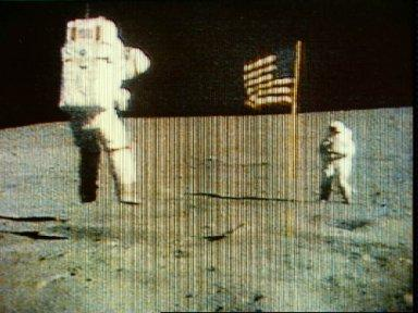 Astronaut John Young leaps from lunar surface as he salutes U.S. flag