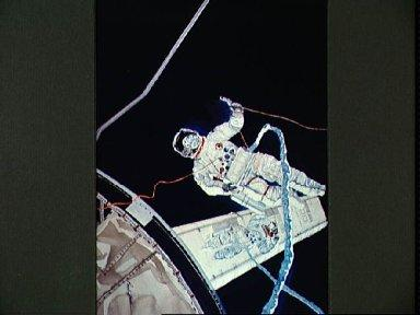 Artist's concept of Astronauts Kerwin and Conrad repairing solar array wing