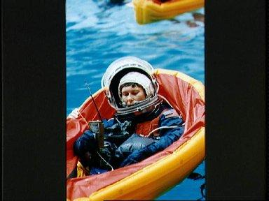 STS-42 Payload Specialist Bondar in single person life raft at JSC's WETF