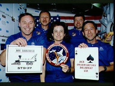 STS-37 crewmembers pose for onboard crew portrait on OV-104's middeck