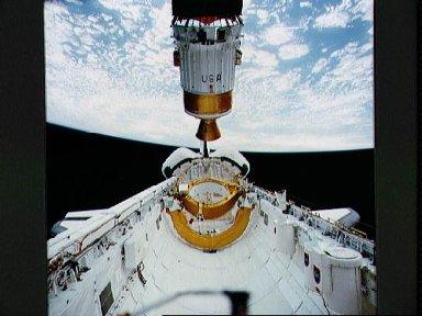 STS-43 TDRS-E / IUS is deployed from OV-104's payload bay (PLB)