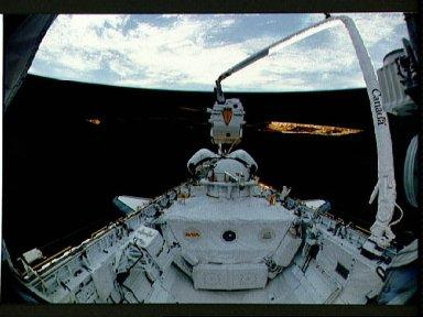 STS-46 EURECA-1L held in pre-deployment position by RMS over OV-104's PLB