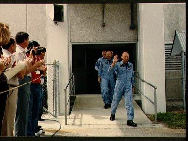 STS 51-F crewmembers depart KSC's operations and checkout building
